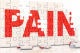 "The word ""PAIN"" in puzzle pieces, highlighting post-surgical pain treatment."