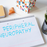 peripheral neuropathy written in a notebook on white table.