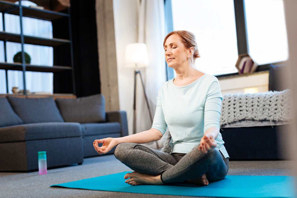 Morning meditation. Tranquil good-looking woman meditating with closed eyes while having connected fingertips, learning What Mental Exercises Can Help with Pain Management.