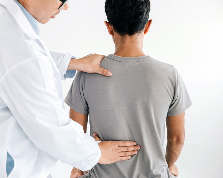 Back and spine exam by doctor.