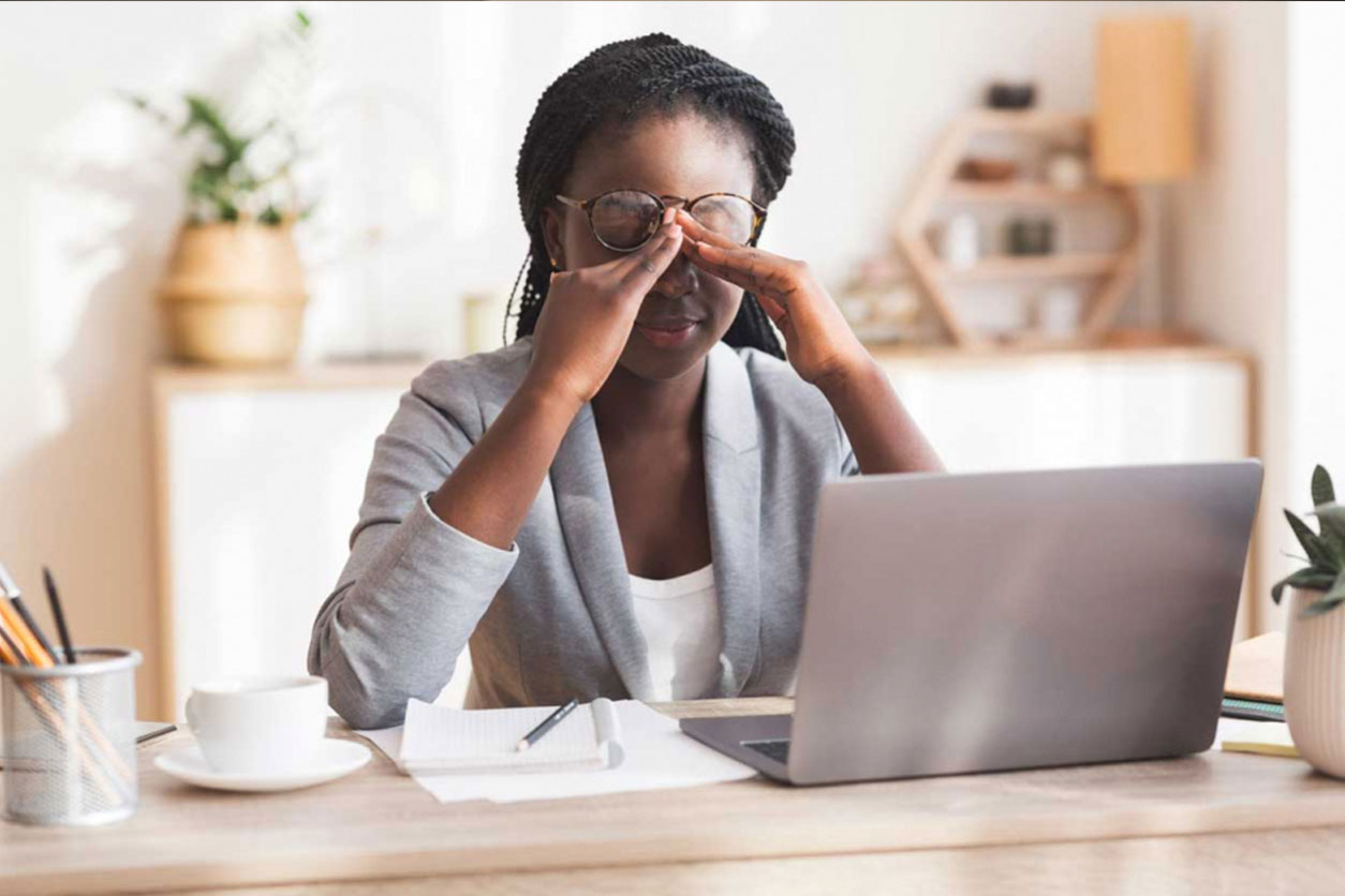 Overworked Black Businesswoman Massaging Nosebridge At Workplace Having Eyesight Problem, Selective Focus, wondering How Stress and Fear Can Impact Your Pain.