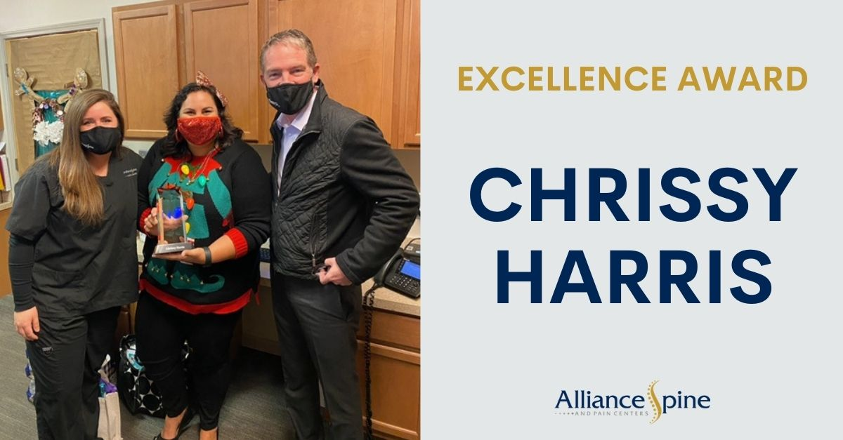 Photo of Alliance Staff Chrissy with Excellence Award