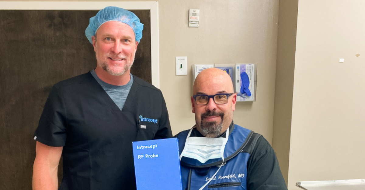 Photo of Dr. Rosenfeld (right) and Intracept rep (left) holding an Intracept RF Probe.