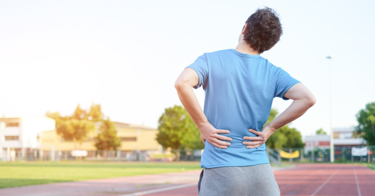 Man in a blue shirt suffering from disc herniation