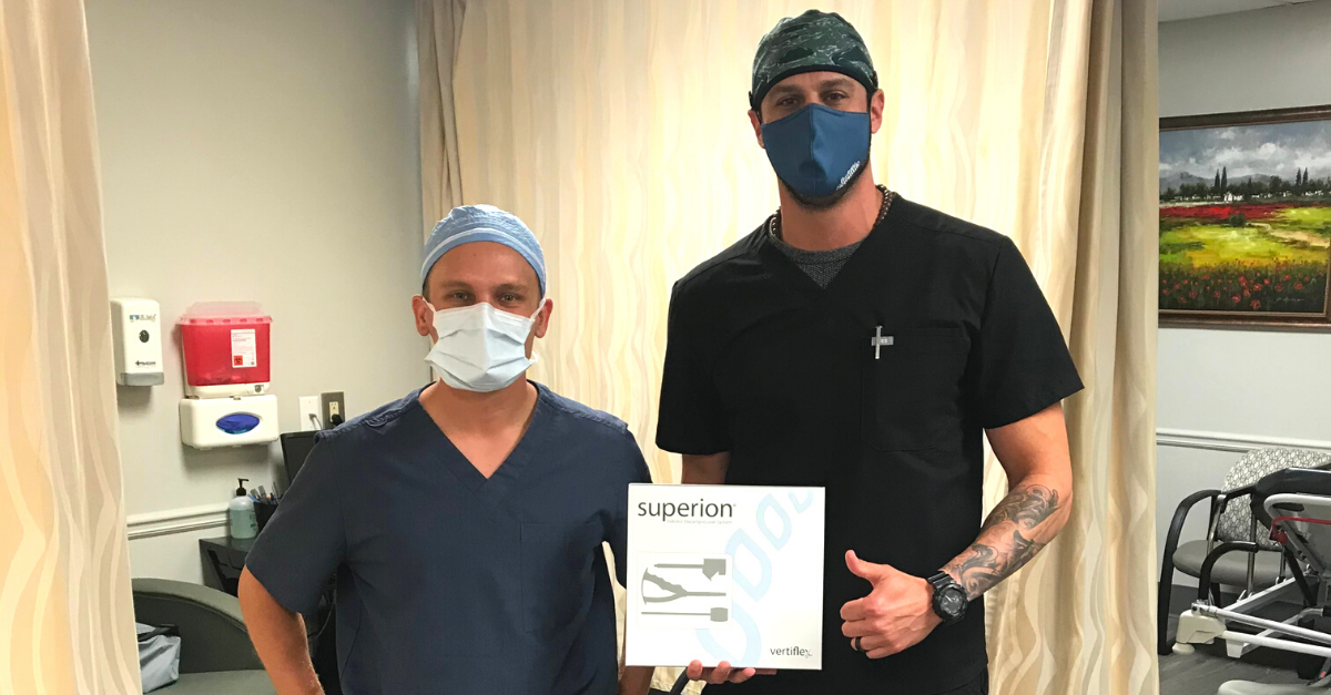 Dr. Scott Masson and Vertiflex rep posting with the Superion Vertiflex treatment box.
