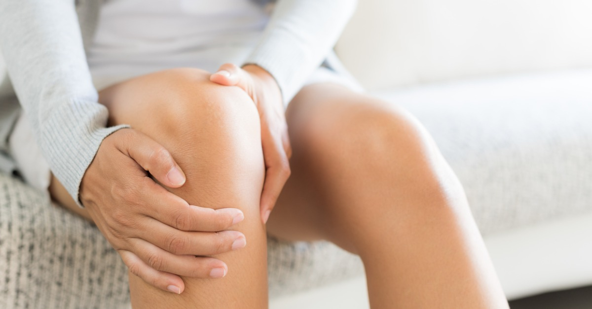 Close-up of a woman holding her knee